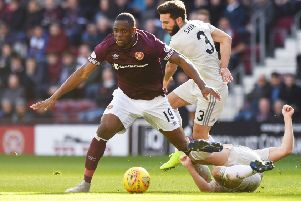Uche Ikpeazu holds off Aberdeen captain Graeme Shinnie during an impressive performance at Tynecastle on Saturday. Picture: SNS.
