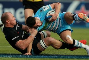 Glasgow No 10 Adam Hastings is tackled by Saracens' Schalk Burger. Picture: SNS.