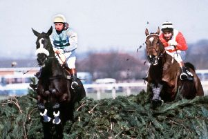 Rubstic, left,  leads at the final fence before winning the 1979 National.