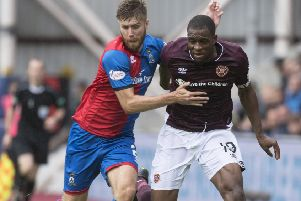 Uche Ikpeazu battles with Inverness' Shaun Rooney. Picture: SNS/Craig Foy