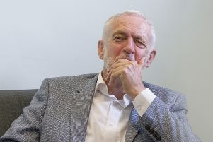 Jeremy Corbyn appears lost in thought, perhaps about his supporters' alleged sleeping habits. Or perhaps not (Picture: John Devlin)