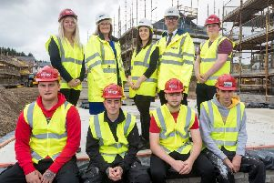 Stewart Milne Group HR director Karen Catto, resource manager Terrie Tully and construction and technical director Neil Thomson with the group's 2018 apprentices. Picture: Contributed