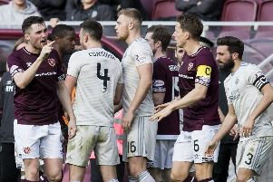 John Souttar exchanges words with the Aberdeen players during the confrontation. Picture: SNS Group