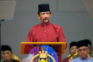 Brunei's Sultan Hassanal Bolkiah has introduced laws that could see gay people stoned to death (Picture: AFP/Getty)