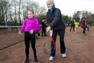Judy Murray passes on some tips as she attends a family day at the courts in Maryhill Park. Picture: SNS.