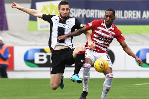 Hamilton's Mickel Miller and St Mirren's Mateo Muzek battle for the ball. Pic: SNS/Paul Devlin