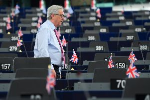 EU Commission president Jean-Claude Juncker walks through the Chamber before a debate on the conclusions of the last European Council. Picture: PATRICK HERTZOG/AFP/Getty Images