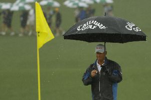 Sandy Lyle needed his brolly on his way to a second-round 75. Picture: AP Photo/Matt Slocum