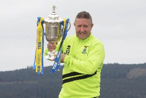 John Robertson is hoping to get his hands on the Scottish Cup for real next month. Picture: Craig Foy/SNS