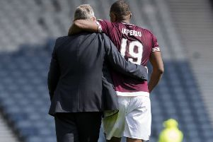 Hearts manager Craig Levein with Uche Ikpeazu at full time. Pic: SNS/Craig Foy