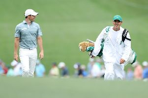 Rory McIlroy walks with caddie Harry Diamond during the third round at Augusta National. Picture: Getty Images