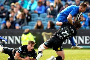 Leinster's Jordan Larmour is halted by a tackle from Glasgow Warriors' Peter Horne during the visitors' 39-24 victory in Dublin. Picture: Rex/Shutterstock
