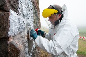 Cleaning graffiti off St Anthony's Chapel in Holyrood Park