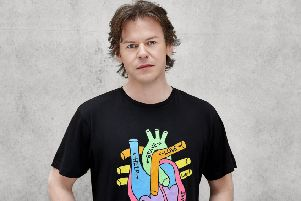 Christopher Kane wears one of his exclusive design Heart of Scotland Appeal T-shirts