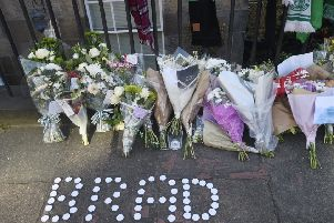 Floral tributes have been left near the scene where Bradley Welsh was shot and killed on Wednesday evening on Chester Street. Picture: Greg Macvean