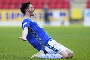 St Johnstone's Scott Tanser celebrates his goal to open the scoring. Pic: SNS/Ross Parker