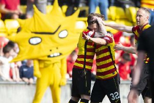 Partick's Joe Cardle celebrates with teammates. Pic: SNS/Sammy Turner