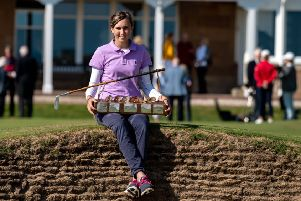 Slovenia's Pia Babnik poses with the Helen Holm Trophy after her victory at Royal Troon. Picture: Scottish Golf