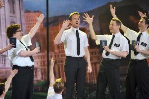 Host Neil Patrick Harris performs with the cast of 'Book of Mormon' onstage at the 66th Annual Tony Awards  (Picture: Theo Wargo/Getty Images)