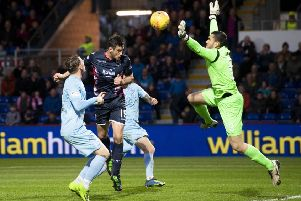 Brian Graham heads past Queen of the South keeper Deniz Mehmet to complete Ross County's 4-0 victory. Picture: SNS.