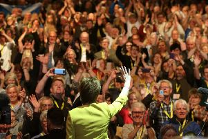 Nicola Sturgeon waves to delegates after her speech during the SNP spring conference at the EICC. Picture: PA