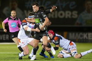 Glasgow 'Warriors' Adam Hastings is tackled by Edinburgh's Simon Berghan. Picture: SNS