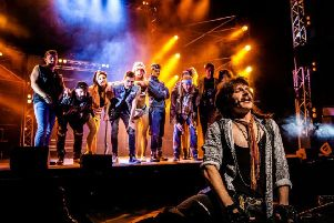 Lucas Rush as Lonny and the cast of Rock of Ages