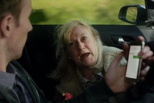 The driver's gran admonishes him for texting at the wheel