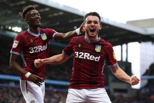 John McGinn celebrates a goal against Middlesbrough with Tammy Abraham in March. Picture: Getty Images