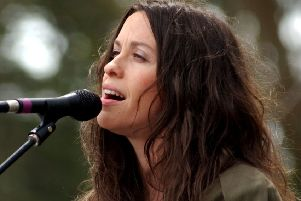 Alanis Morissette performs in 2003 when life somehow seemed simpler (Picture: Tim Mosenfelder/Getty Images)