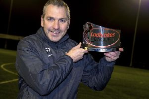 Montrose manager Stewart Petrie with his Ladbrokes League 1 Manager of the Month award for December. Picture: Alan Harvey/SNS