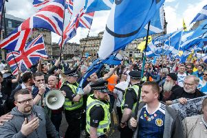 Unionists and Scottish independence supporters during a march by the latter