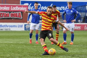 Partick's Stuart Bannigan makes it 3-0 from the spot. Pic: SNS/Sammy Turner