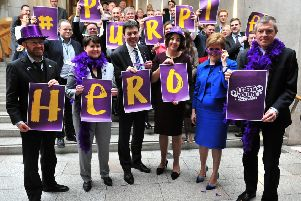 Scotland's party leaders dress in purple to celebrate LGBT rights in 2017. Pic: Lisa Ferguson.