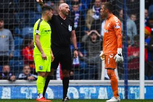 Rangers Alan McGregor is sent off for kicking out at Marc McNulty. Picture: SNS