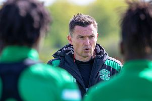 Paul Heckingbottom speaks to his players at Hibs' East Mains training centre. Picture: SNS Group