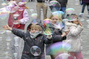 It's party time on the Royal Mile as kids play amongst bubbles during the Open Streets event. Picture: Neil Hanna