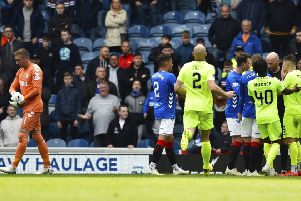 Allan McGregor gets his marching orders at  Ibrox yesterday after kicking out at Hibs'  Marc McNulty.