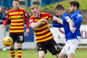 Andrew Stirling and Kyle Jacobs of Queen of the South battle with Partick's Shea Gordon during a Championship clash. Picture: SNS Group