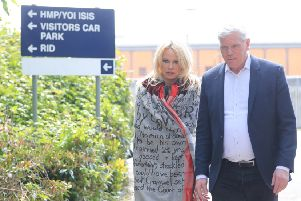 US actress Pamela Anderson leaves Belmarsh Prison in south-east London, accompanied by WikiLeaks editor Kristinn Hrafnsson after she visited WikiLeaks founder Julian Assange. Picture: Gareth Fuller/PA Wire