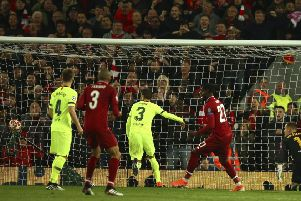 Divock Origo scores Liverpool's fourth goal to complete their comeback against Barcelona and send the Merseysiders  to the Champions League final. Picture: AP.
