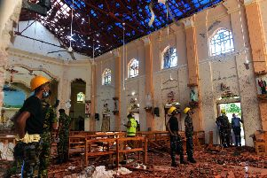 Security personnel inspect the interior of St. Sebastian's Church in Negombo a day after the church was hit in series of bomb blasts targeting churches and luxury hotels in Sri Lanka. Picture: AFP/Getty Images