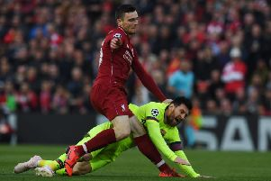 Liverpool defender Andy Robertson tangles with Barcelona's Lionel Messi during the epic Anfield clash. Picture: Paul Ellis/AFP/Getty
