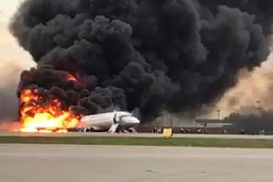 Forty-one people died when this plane made an emergency landing at an airport in Moscow, but would 37 people have survived if they had been drunk? (Picture: AFP/Getty)
