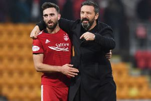 Derby County-bound Graeme Shinnie with Aberdeen boss Derek McInnes, who is facing a summer rebuilding job at Pittodrie. Picture: SNS