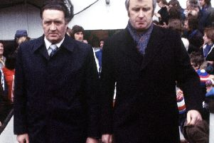 Celtic boss Jock Stein, left, and Rangers manager Jock Wallace walk out together.