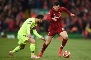 Andrew Robertson gets the better of Barcelona's  Lionel Messi on Tuesday evening. Picture: Oli Scarff/AFP/Getty