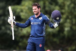 Scotland's Calum MacLeod celebrates his century against Afghanistan. Picture: Ian MacNicol/Getty