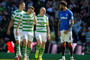 Scott Brown exchanges words with Connor Goldson after Celtic opened the scoring in the last Old Firm derby in March. Picture: SNS