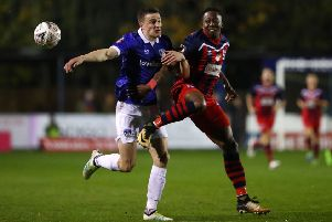 George Edmundson battles with Chris Dickson of Hampton & Richmond Borough during an FA Cup match. Picture: Getty Images